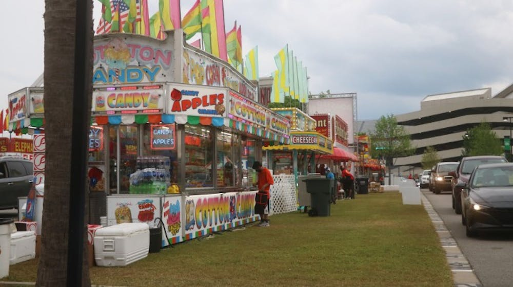 Vendors at the South Carolina drive-thru State Fair take orders from cars and deliver the food directly to them. Customers could order popular fair foods such as cotton candy, fried Oreos and more.