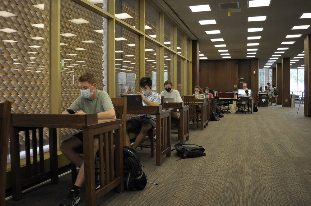 <p>Students sit in USC's Thomas Cooper Library. To follow the university's current mask mandate, students must wear masks in all university buildings and classrooms.&nbsp;</p>