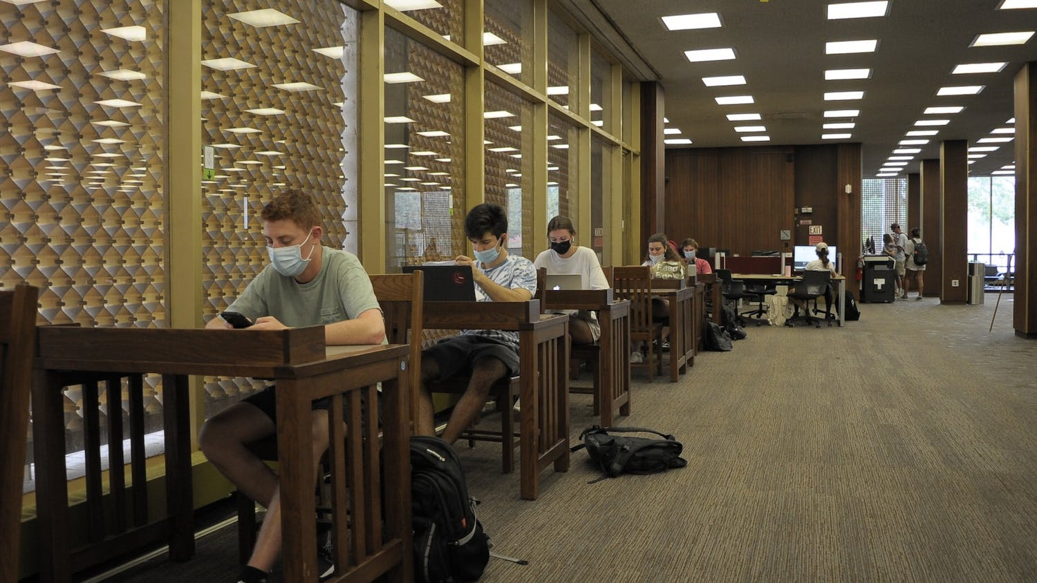 Students sit in USC's Thomas Cooper Library. To follow the university's current mask mandate, students must wear masks in all university buildings and classrooms.