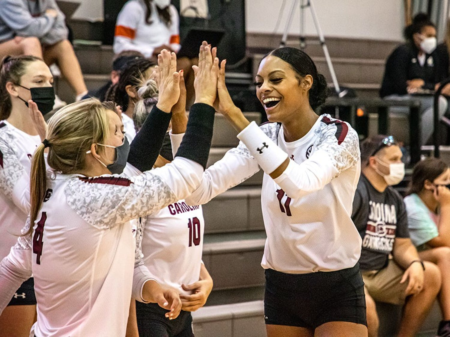 Senior Lauren Bowers high-fives senior Mikayla Robinson after Robinson scores a point. The Gamecocks defeated the Winthrop Eagles in three straight sets.