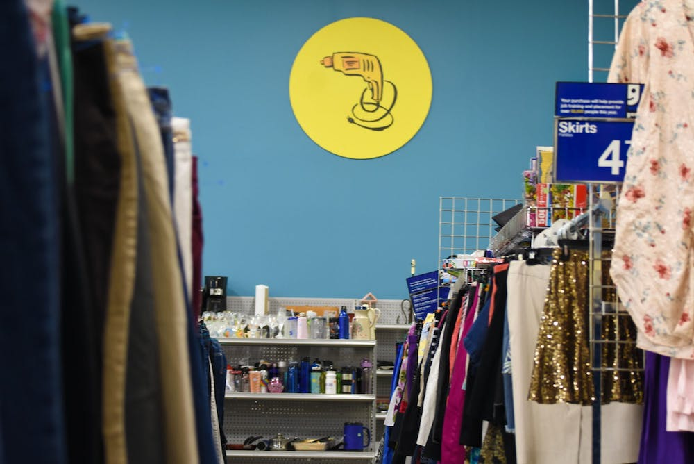<p>An aisle within a Goodwill retail store. The act of thrifting and the rise of secondhand-centered e-commerce apps have become popular among college students who seek to buy clothing at lower prices and combat unsustainable practices within the fashion industry.</p>