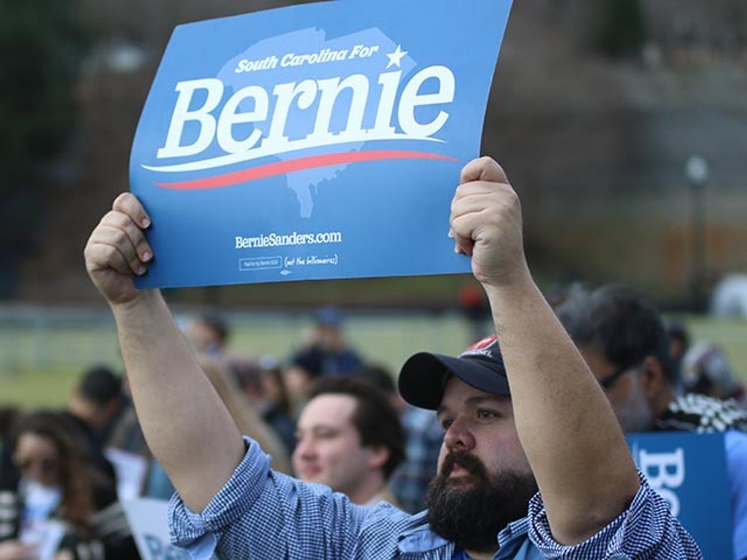 Bernie Sanders supporter Clay Haill holds up a sign in support at Friday's Bernie 2020 South Carolina rally at Finlay Park.