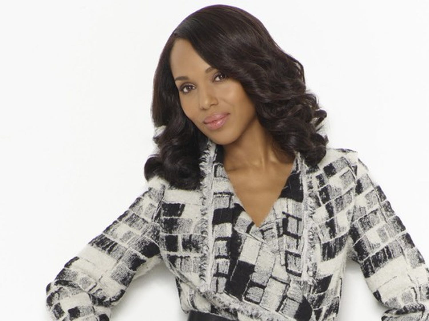 White and black are the most frequented colors in Olivia Pope's style palette, often channeled through a classic peacoat or blazer.