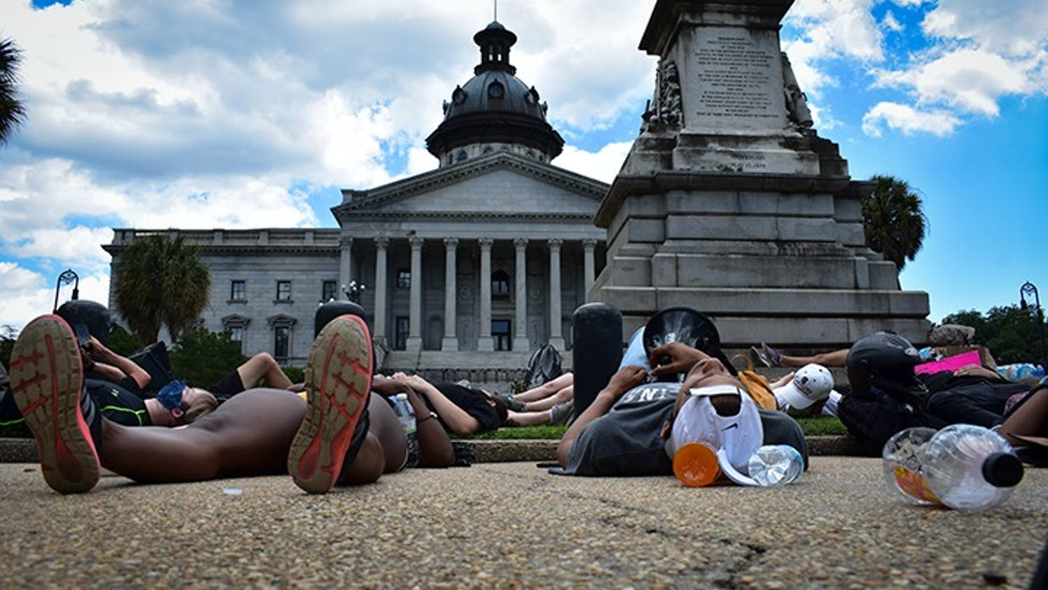 """Peaceful protesters lie down in front of the Statehouse Monday for a """"Die-In."""""""