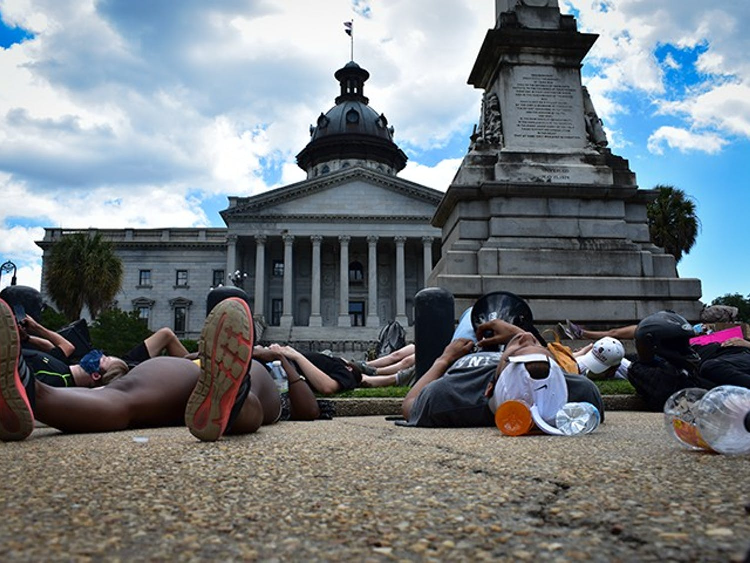 "Peaceful protesters lie down in front of the Statehouse Monday for a ""Die-In."""
