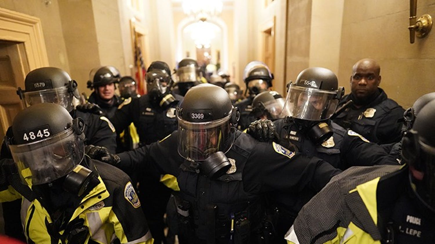 Riot police clear the hallway inside the Capitol on Wednesday, Jan. 6, 2021, in Washington, D.C.