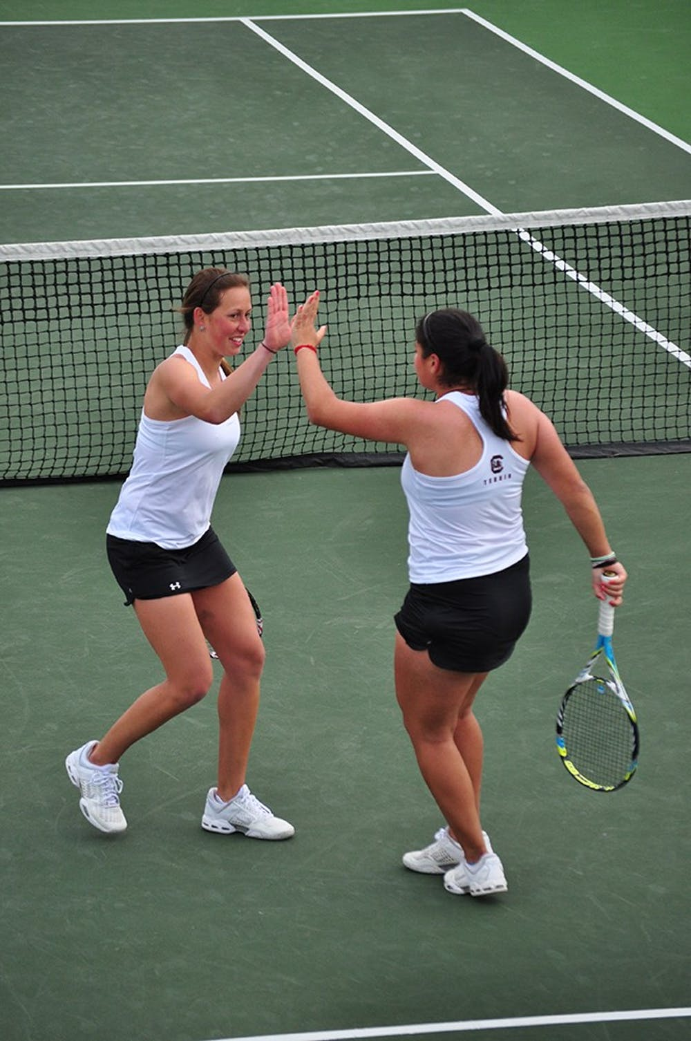 <p>Senior Jaklin Alawi (right) and junior Dominika Kanakova defeated the No. 6 doubles team in the nation.</p>