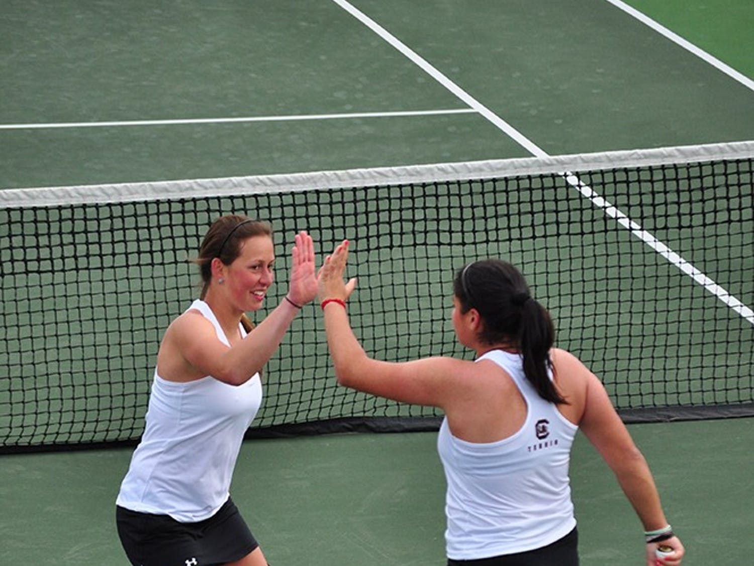 Senior Jaklin Alawi (right) and junior Dominika Kanakova defeated the No. 6 doubles team in the nation.