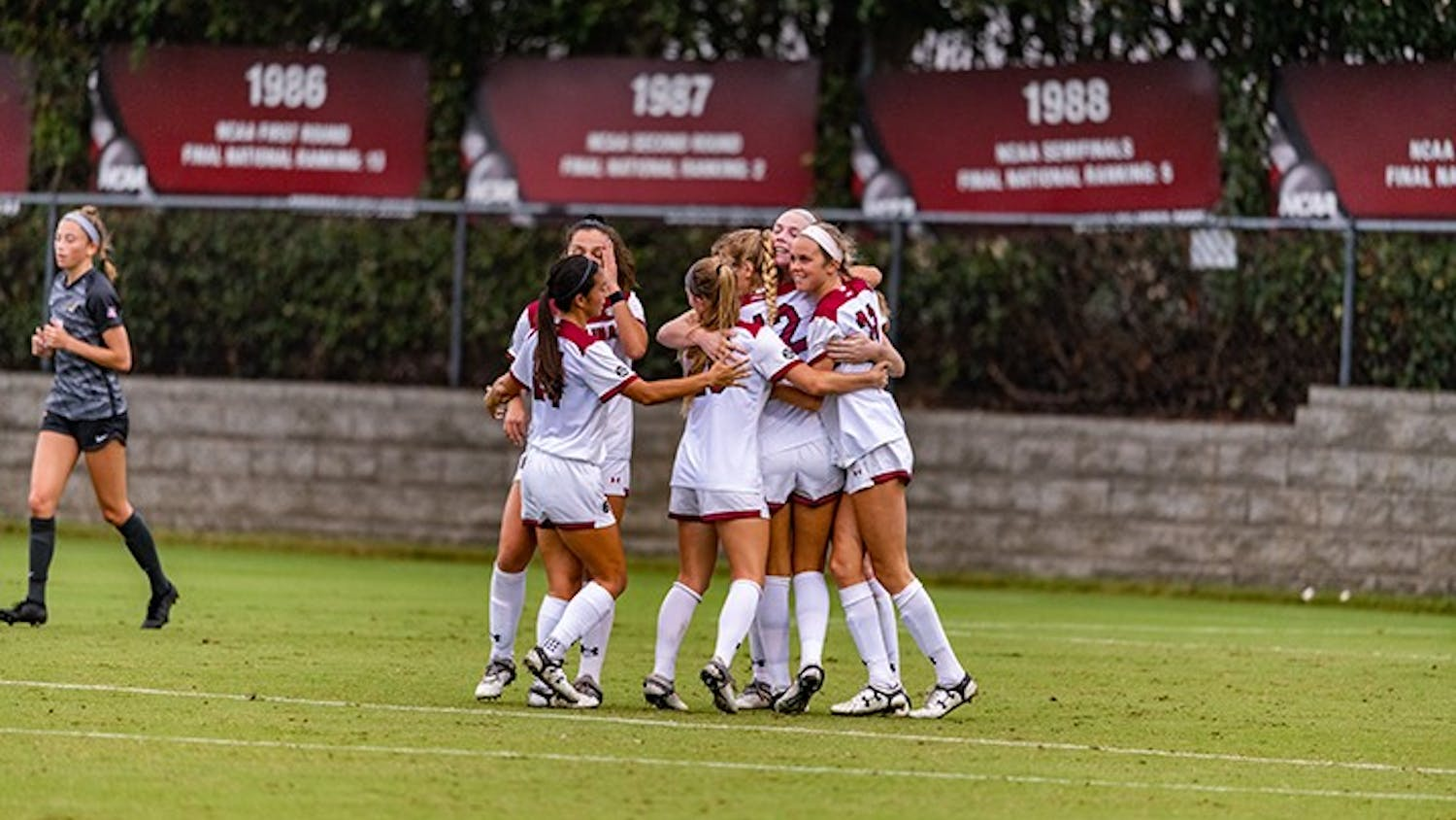 Members of the South Carolina women's soccer team celebrate after a goal in the win against Missouri on Sunday. The win was the first of the season for the Gamecocks.