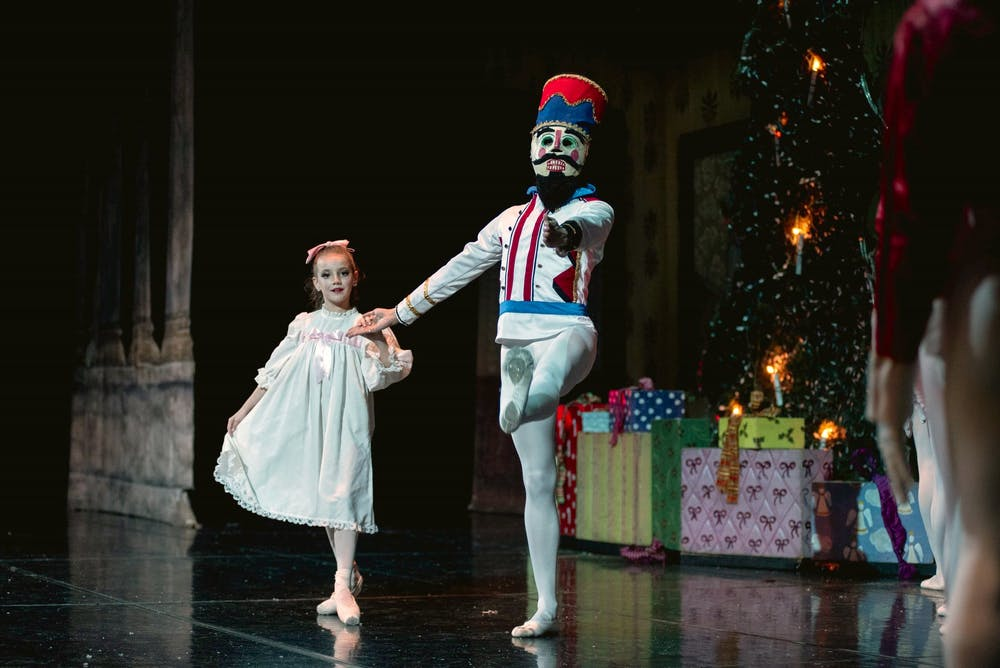 <p>Ava Ramirez, who performs as Clara, and the Nutcracker share a dance in the traditional Christmas ballet.</p>