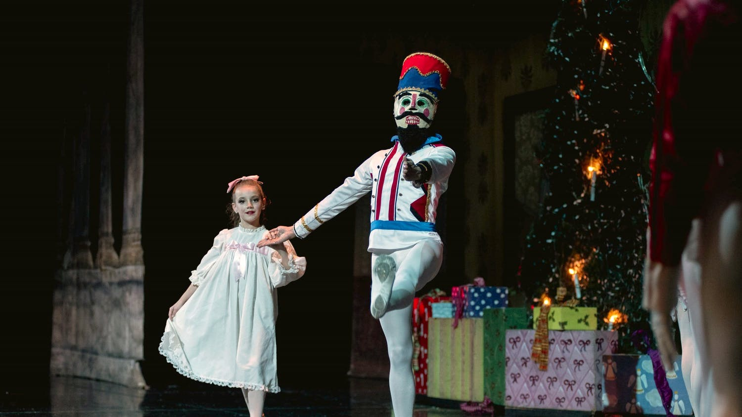 Ava Ramirez, who performs as Clara, and the Nutcracker share a dance in the traditional Christmas ballet.