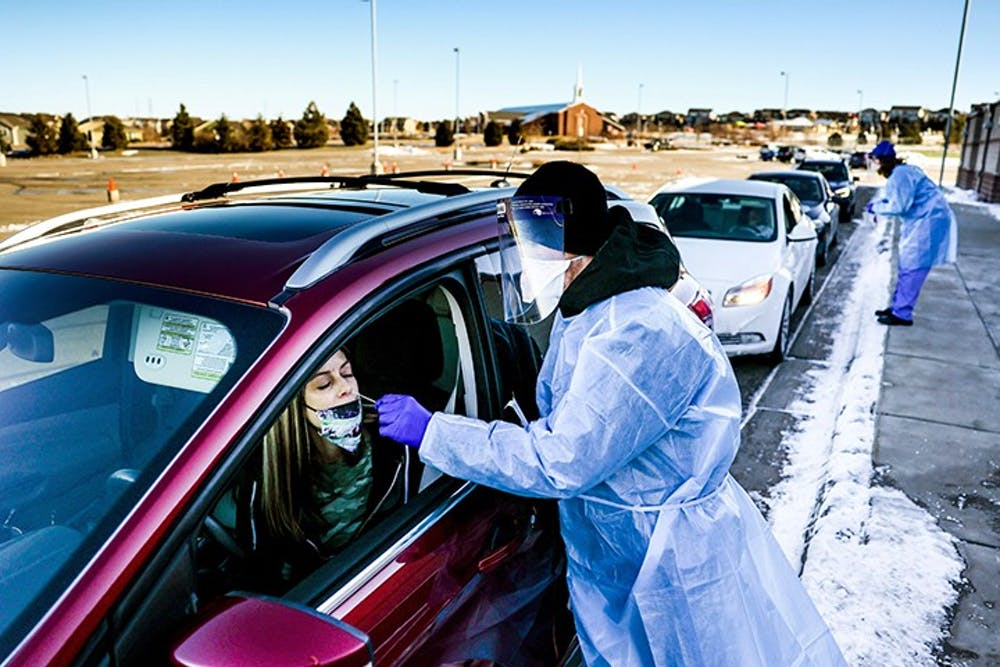 Site tester Bradford Christopher administers a COVID-19 test in Parker, Colorado, the closest testing site to Ebert County where the first positive test for a new highly contagious variant was detected.
