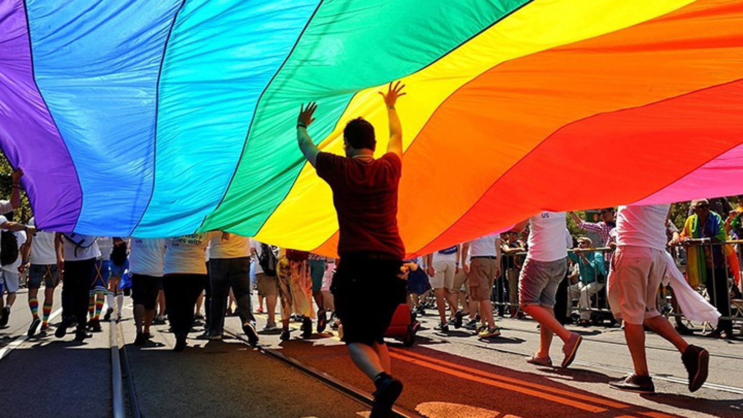 Parade participants march down Market Street carrying the rainbow flag during the annual Gay Pride parade in San Francisco on June 30, 2013. (Wally Skalij/Los Angeles Times/TNS)