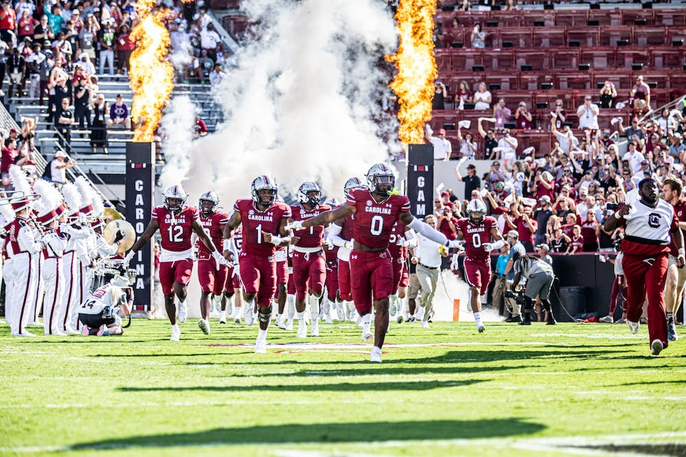 <p>South Carolina football rushes the field for kickoff at the Troy football game Oct. 2, 2021.&nbsp;</p>
