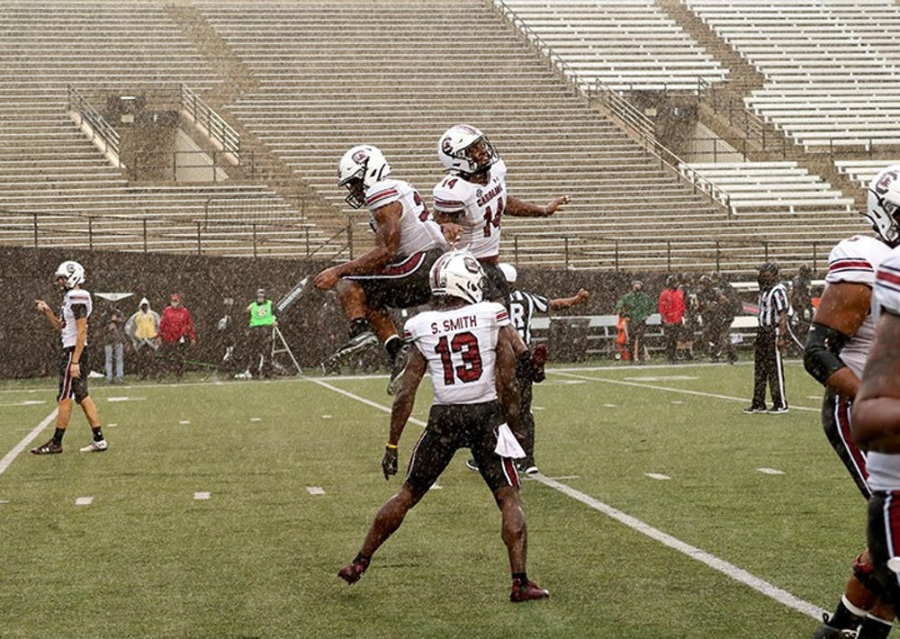 <p>South Carolina football players celebrate in the end zone after scoring a touchdown. The Gamecocks beat the Vanderbilt Commodores 41-7 on Saturday, Oct. 10.</p>