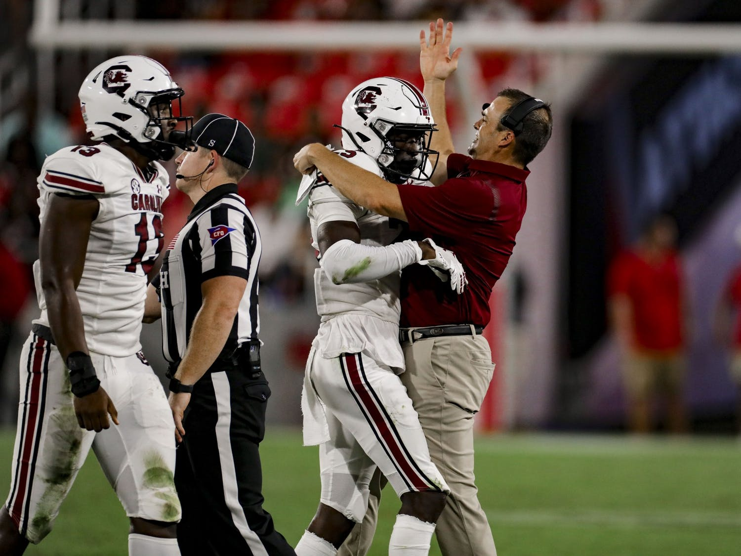 Head coach Shane Beamer celebrates a defensive stop by redshirt freshman defensive back O'Donnell Fortune in South Carolina's game against Georgia on Sept. 18, 2021.
