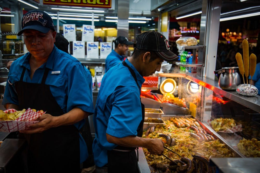 <p>&nbsp;Workers at the South Carolina State Fair prepare food. The fair will be drive-thru only this year.</p>