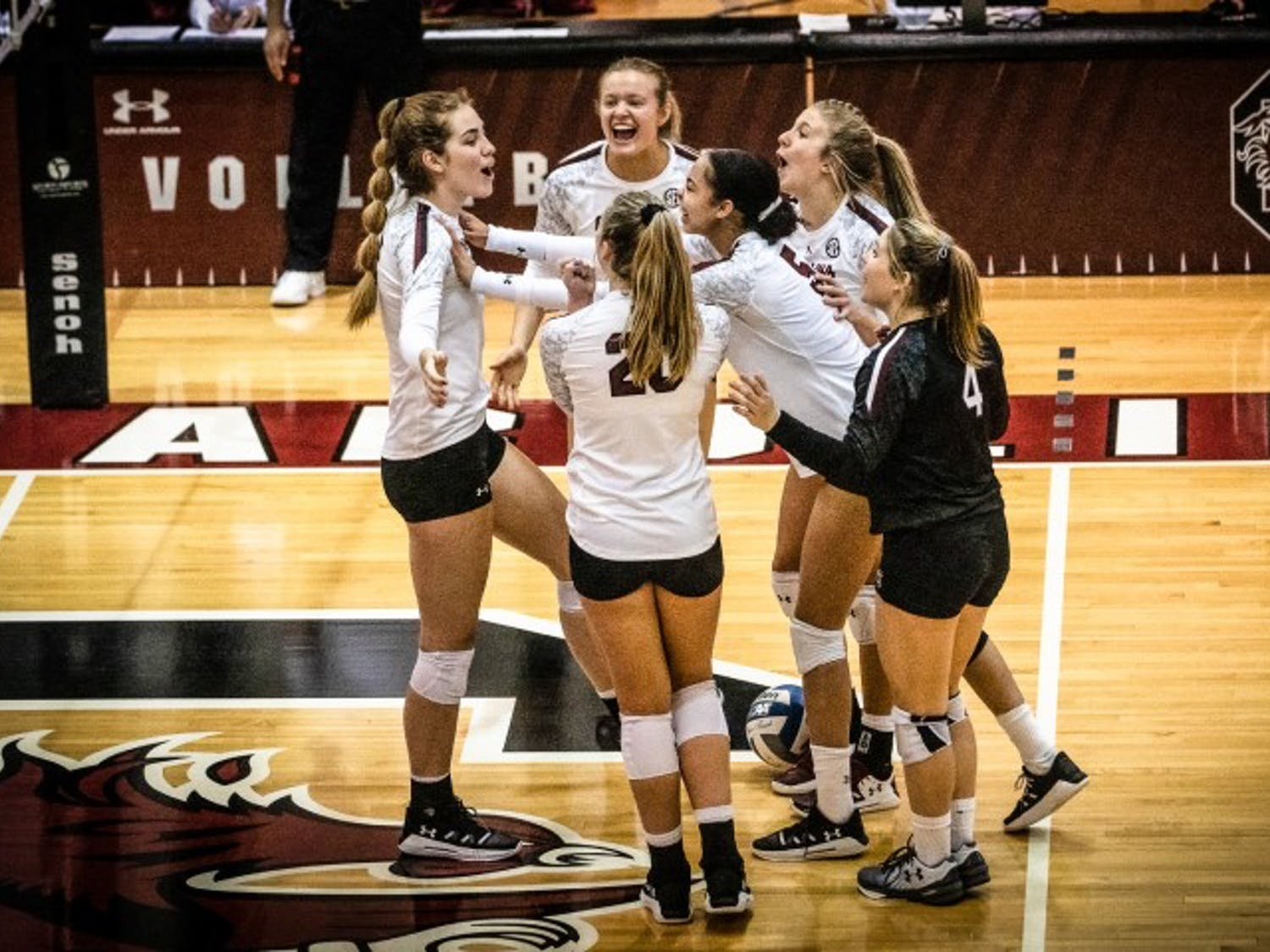 Members of the South Carolina volleyball team celebrate after scoring against Ole Miss.