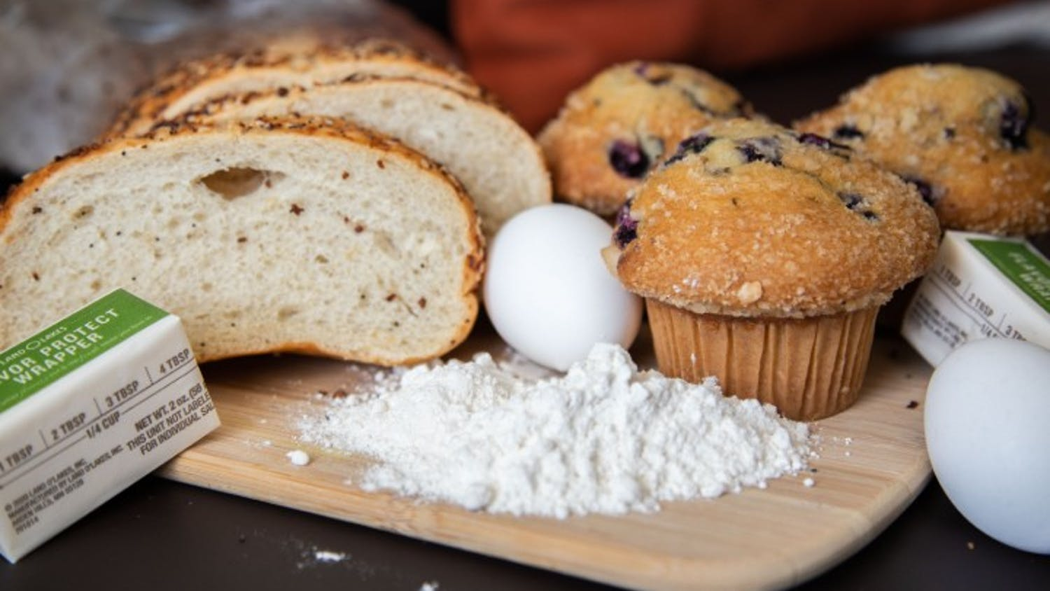 Baking ingredients are laid out across a table.