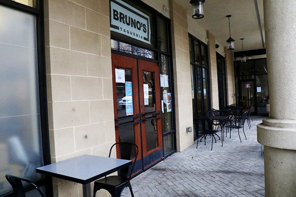 <p>Tables and chairs are arranged in front of Bruno's Taqueria on Main Street, a new family-owned restaurant that specializes in tacos and other authentic Mexican classics.&nbsp;</p>