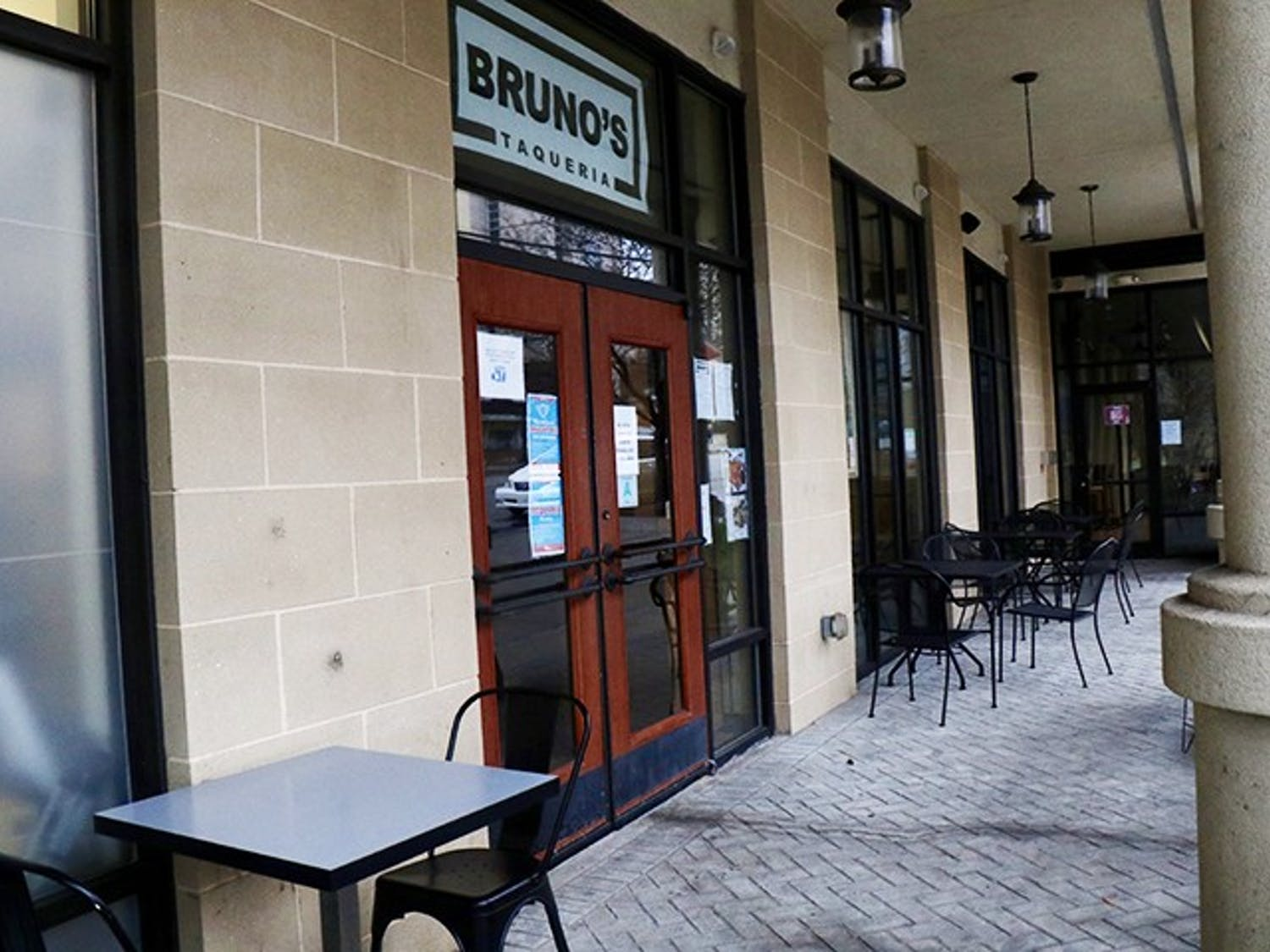 Tables and chairs are arranged in front of Bruno's Taqueria on Main Street, a new family-owned restaurant that specializes in tacos and other authentic Mexican classics.