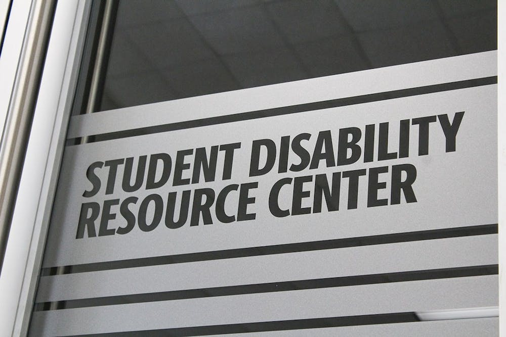 <p>Signage on the door of the newly relocated Student Disabilities Resource Center in Close-Hipp, Suite 102.</p>