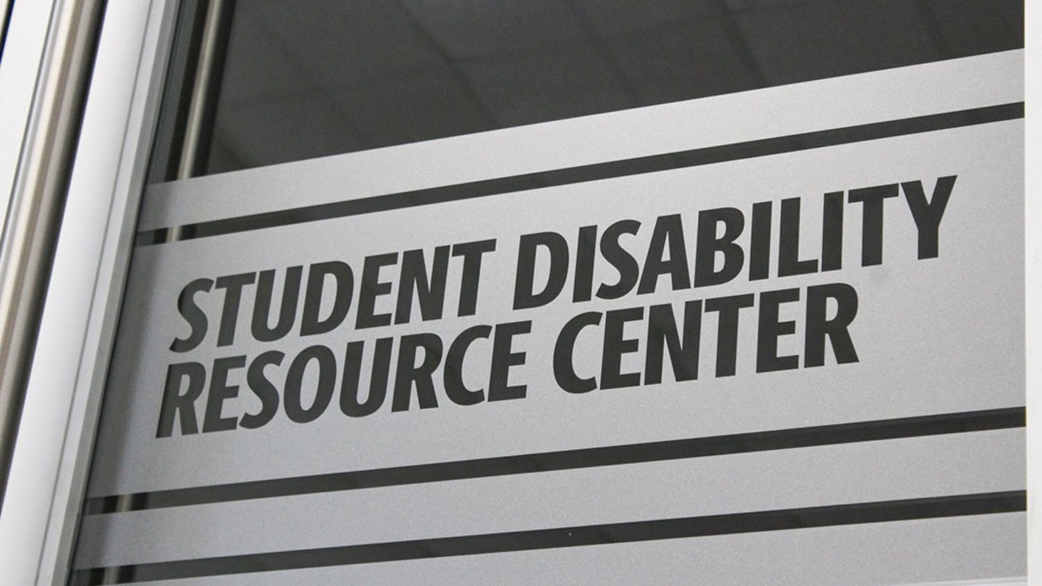 Signage on the door of the newly relocated Student Disabilities Resource Center in Close-Hipp, Suite 102.