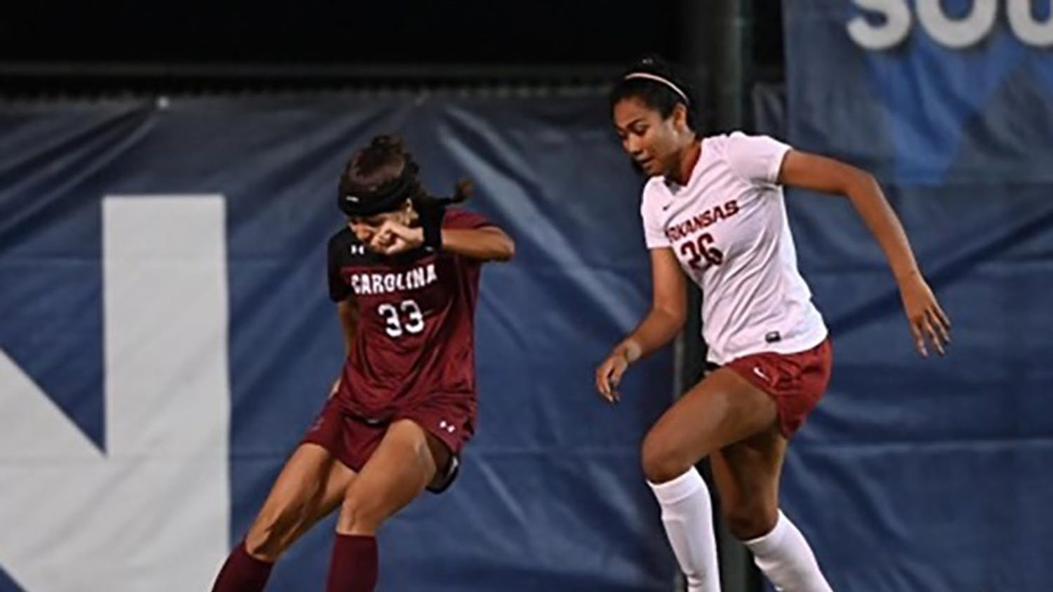 Junior midfielder Jyllissa Harris dribbles the ball around an Arkansas defender in the SEC Tournament semifinals. The Gamecocks fell to the Razorbacks 2-1.