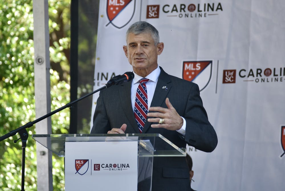 University President Bob Caslen stands at a podium and gives a speech to the crowd.