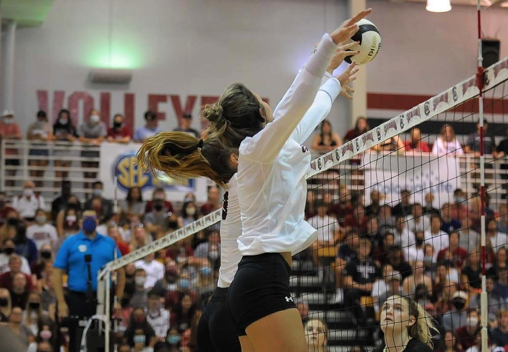 <p>Sophomore blocker Ellie Ruprich returns the volleyball to the Knights next to freshman right side Lauren McCutcheon. The Gamecocks beat the Knights in 3-1 sets, and maintained their undefeated streak.&nbsp;</p>