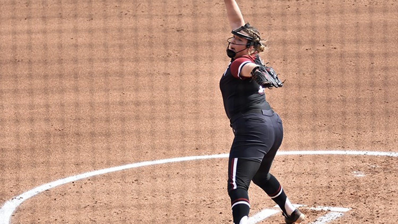 Freshman pitcher Leah Powell pitches the ball against an Arkansas batter.