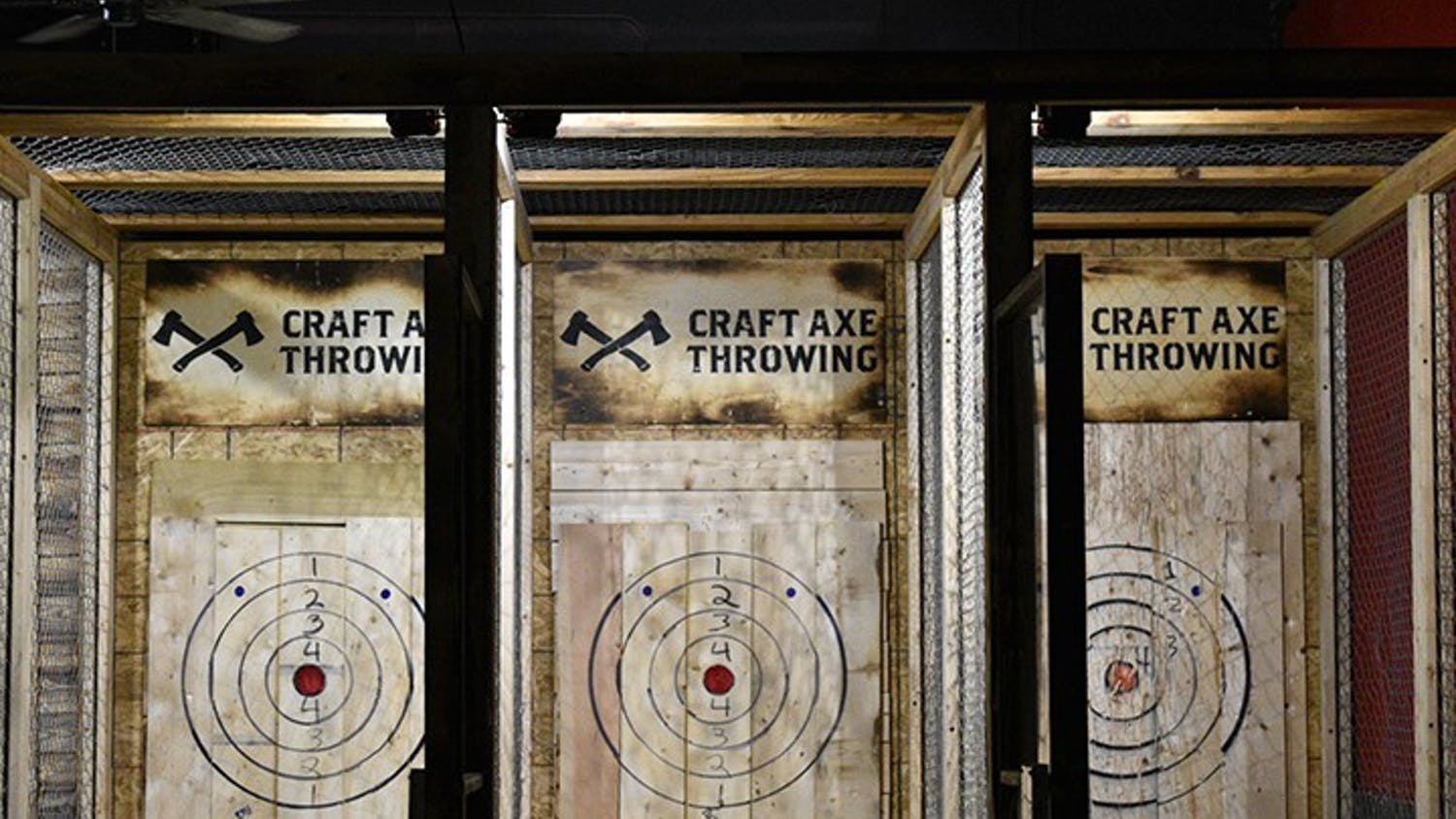 Craft Axe Throwing has divided lanes with bullseye's for customers to throw at.