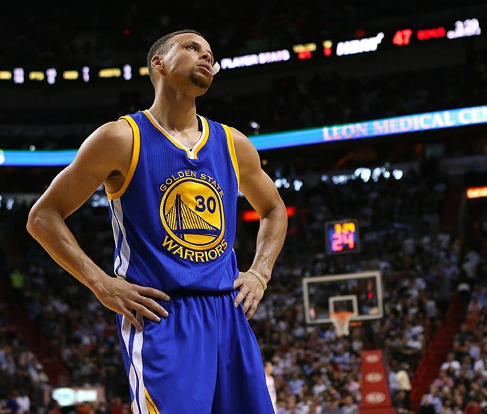 The Golden State Warriors' Stephen Curry reacts after a play against the Miami Heat during the second quarter at the AmericanAirlines Arena in Miami on Wednesday, Feb. 24, 2016. The Warriors won, 118-112. (David Santiago/Miami Herald/TNS)