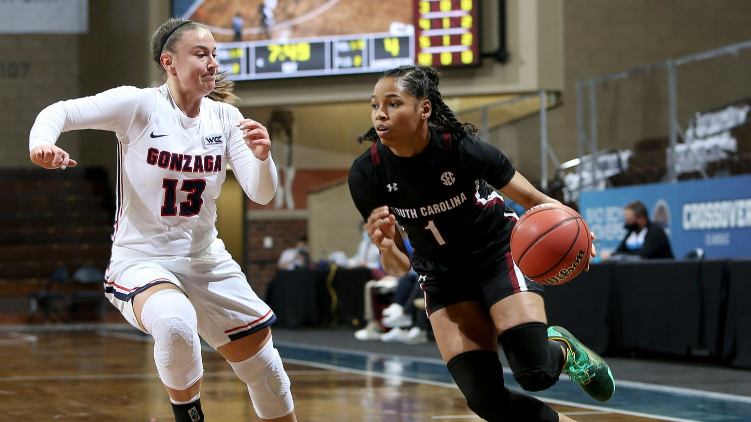Sophomore guard Zia Cooke dribbles the ball around a Gonzaga defender. The Gamecocks won the game 79-72.