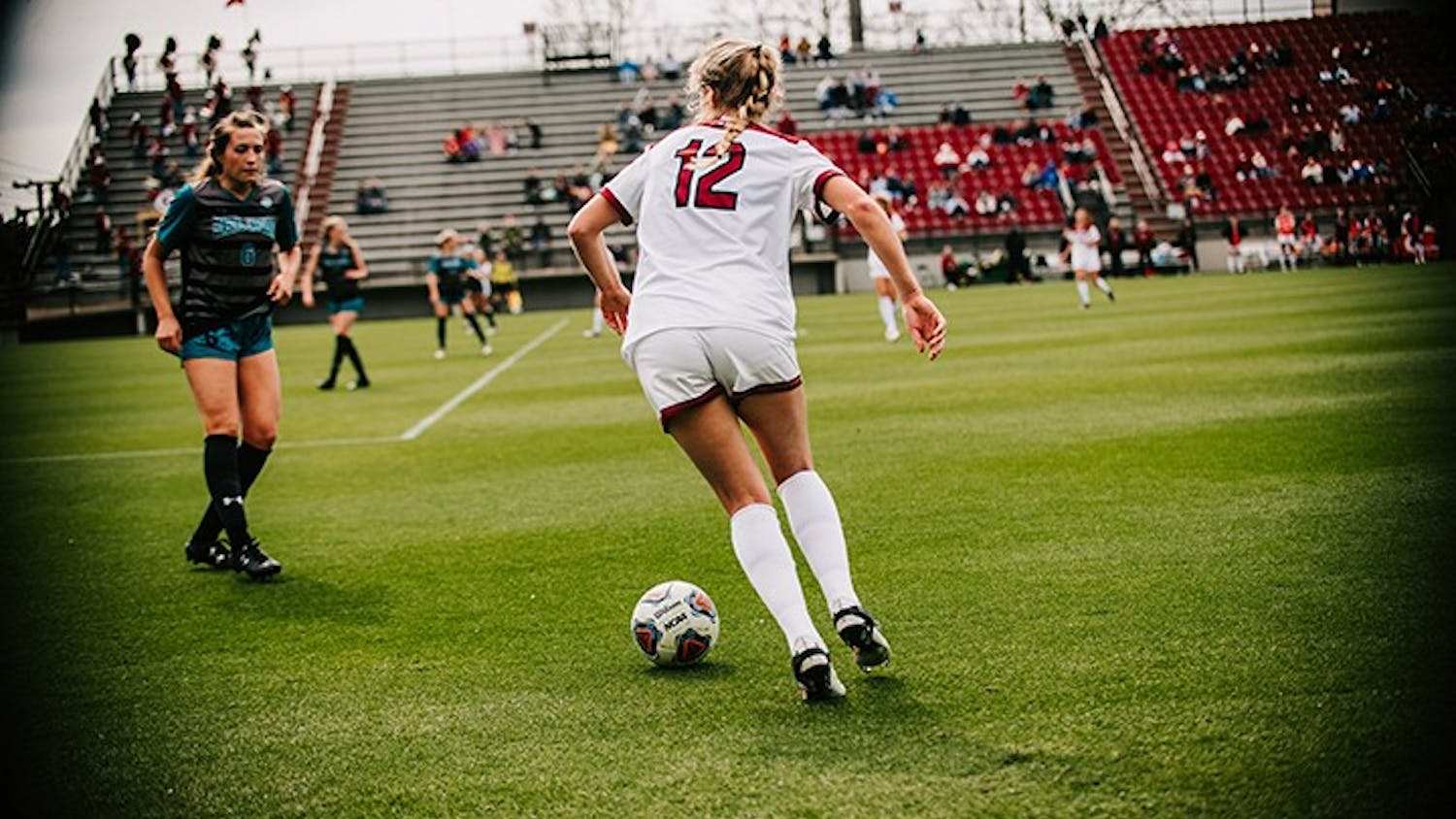Junior defender Sutton Jones looks to dribble past a Coastal Carolina defender. The Gamecocks beat the Chanticleers 3-0 to remain undefeated at home this season.