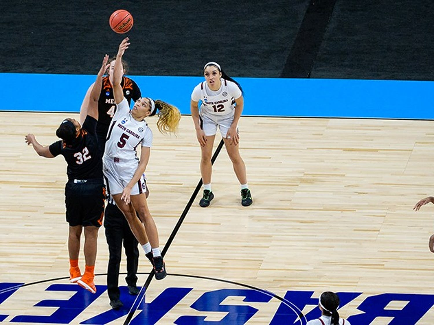 Junior forward Victaria Saxton jumps next to a Mercer player and tries to tip the ball to her fellow teammates. South Carolina beat Mercer in the NCAA Tournament 79-53.