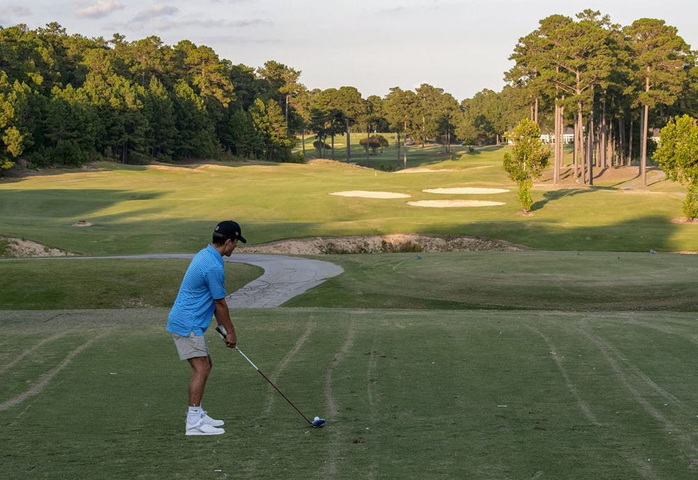 <p>A player getting ready to hit a tee shot onto the course. Oak Hills Country Club Golf Course&nbsp;is north of downtown Columbia and an 18 to 20 minute drive from USC's campus.</p>