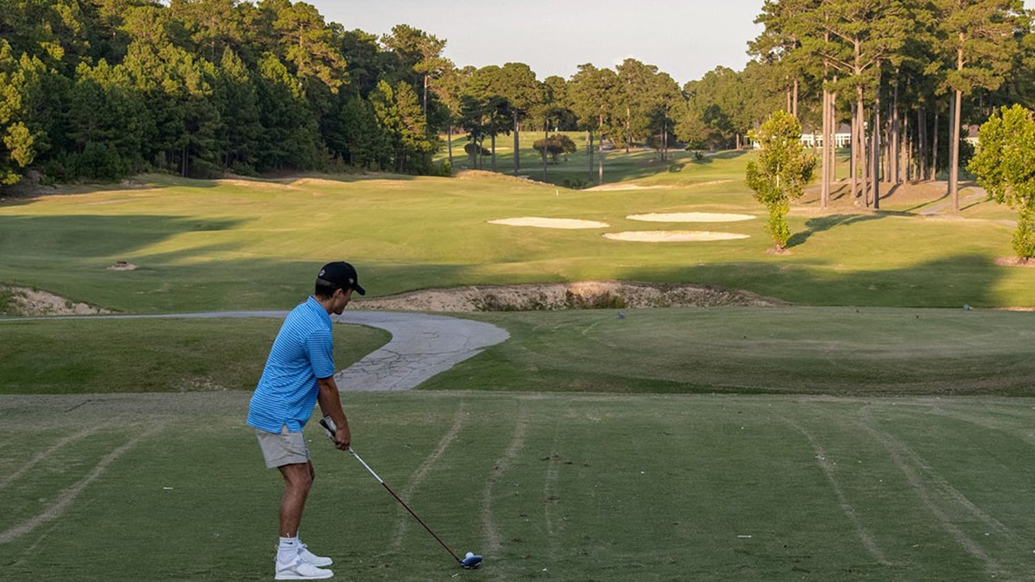 A player getting ready to hit a tee shot onto the course. Oak Hills Country Club Golf Courseis north of downtown Columbia and an 18 to 20 minute drive from USC's campus.