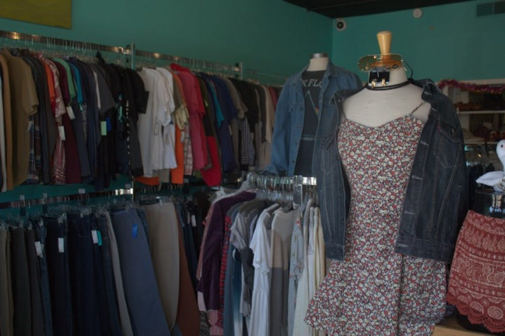 <p>A collection of clothes sits on display at Sid &amp; Nancy, a thrift store in Five Points.</p>