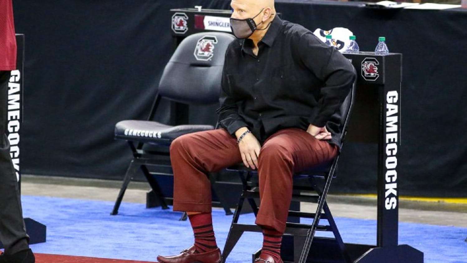 Head basketball coach Frank Martin watches from the sidelines in a 2021 game against Ole Miss.