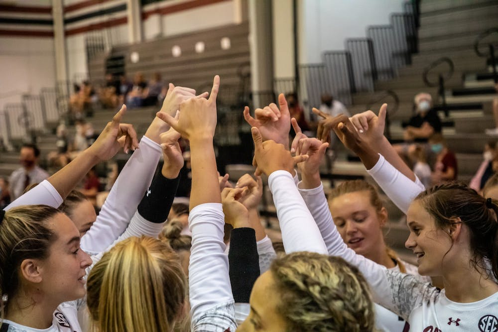 <p>The South Carolina volleyball team holds up the Spurs Up symbol during the game against UCF.</p>