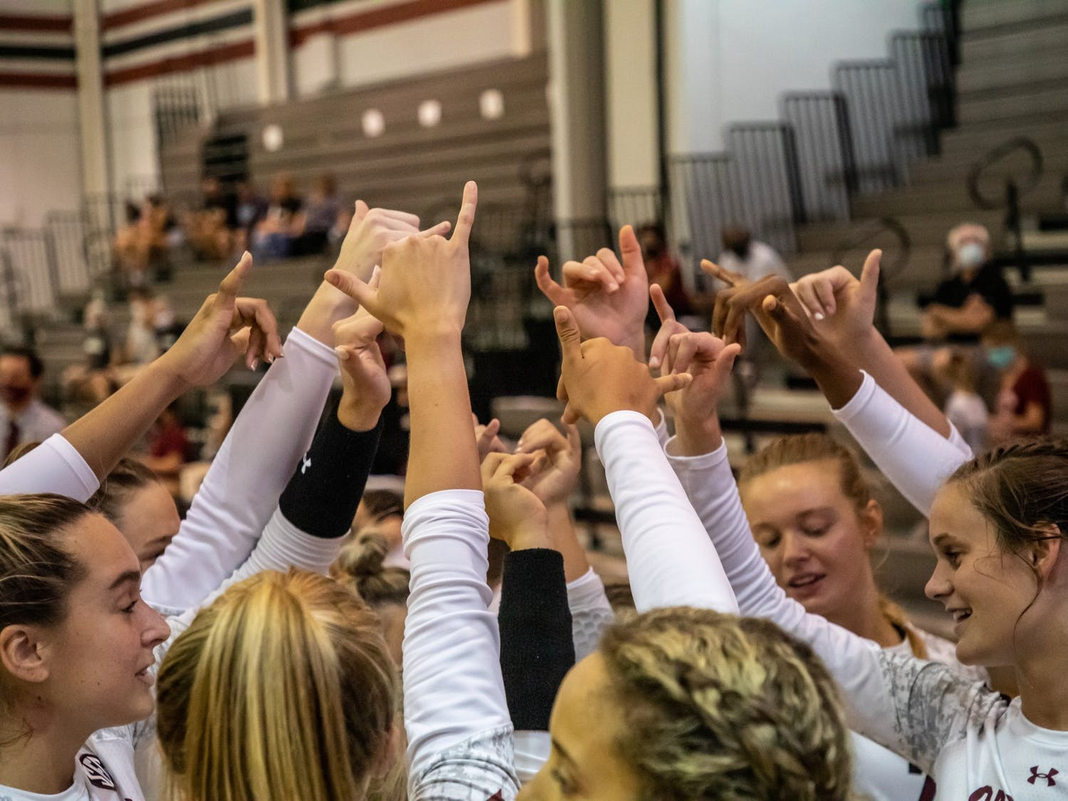 The South Carolina volleyball team holds up the Spurs Up symbol during the game against UCF.