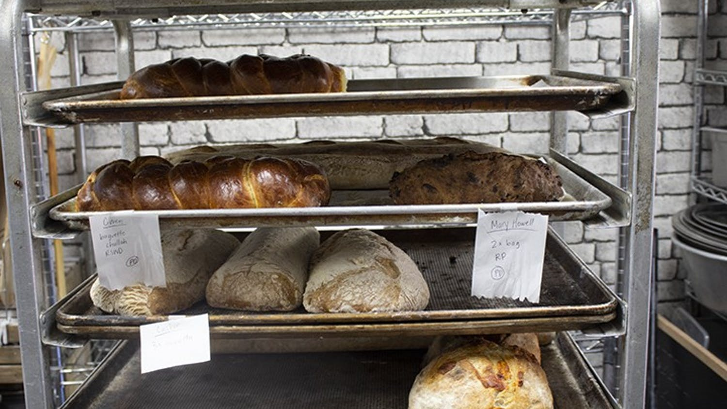 Crust Bakehouseinventory sits on a waiting rack. Crust Bakehouse offers fresh bread, scones, pastries and more.