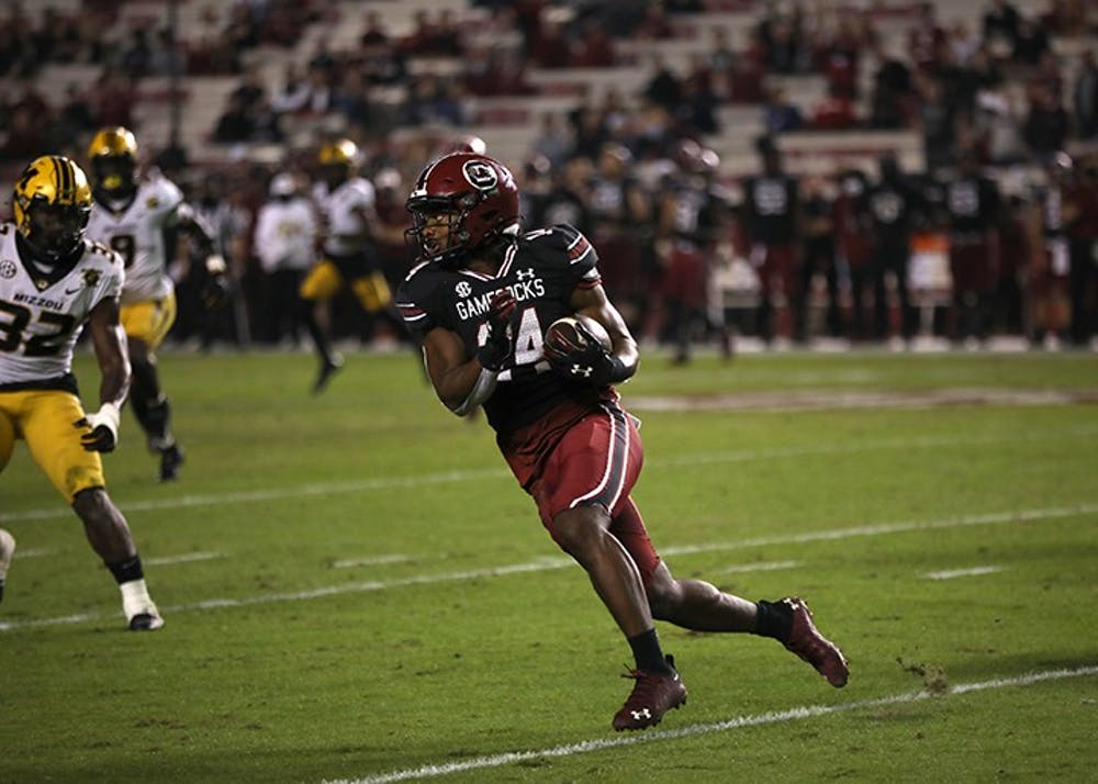 <p>Redshirt sophomore running back Deshaun Fenwick looks downfield as he runs with the ball. The Gamecocks fell to the Missouri Tigers 17-10.</p>