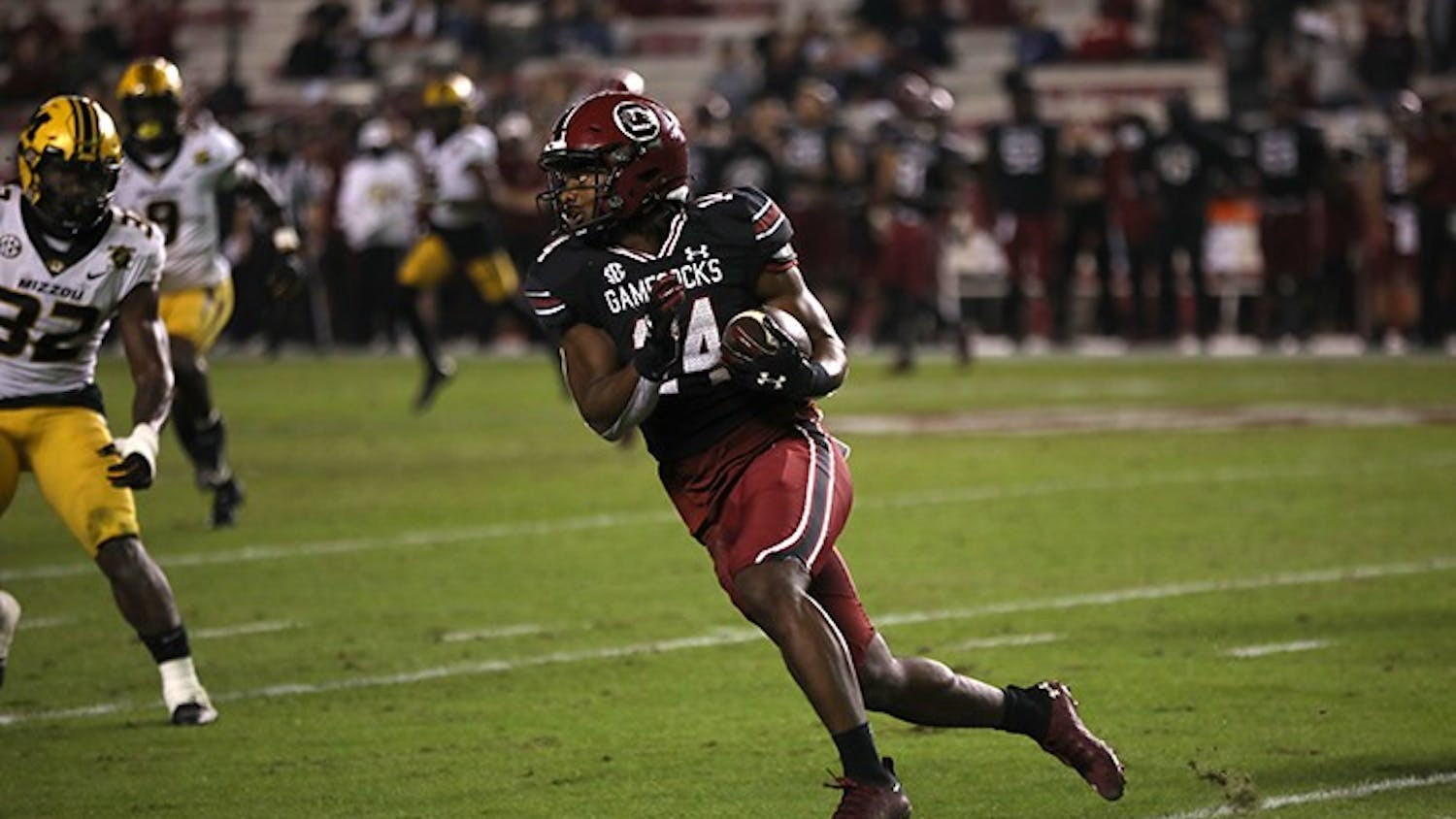 Redshirt sophomore running back Deshaun Fenwick looks downfield as he runs with the ball. The Gamecocks fell to the Missouri Tigers 17-10.