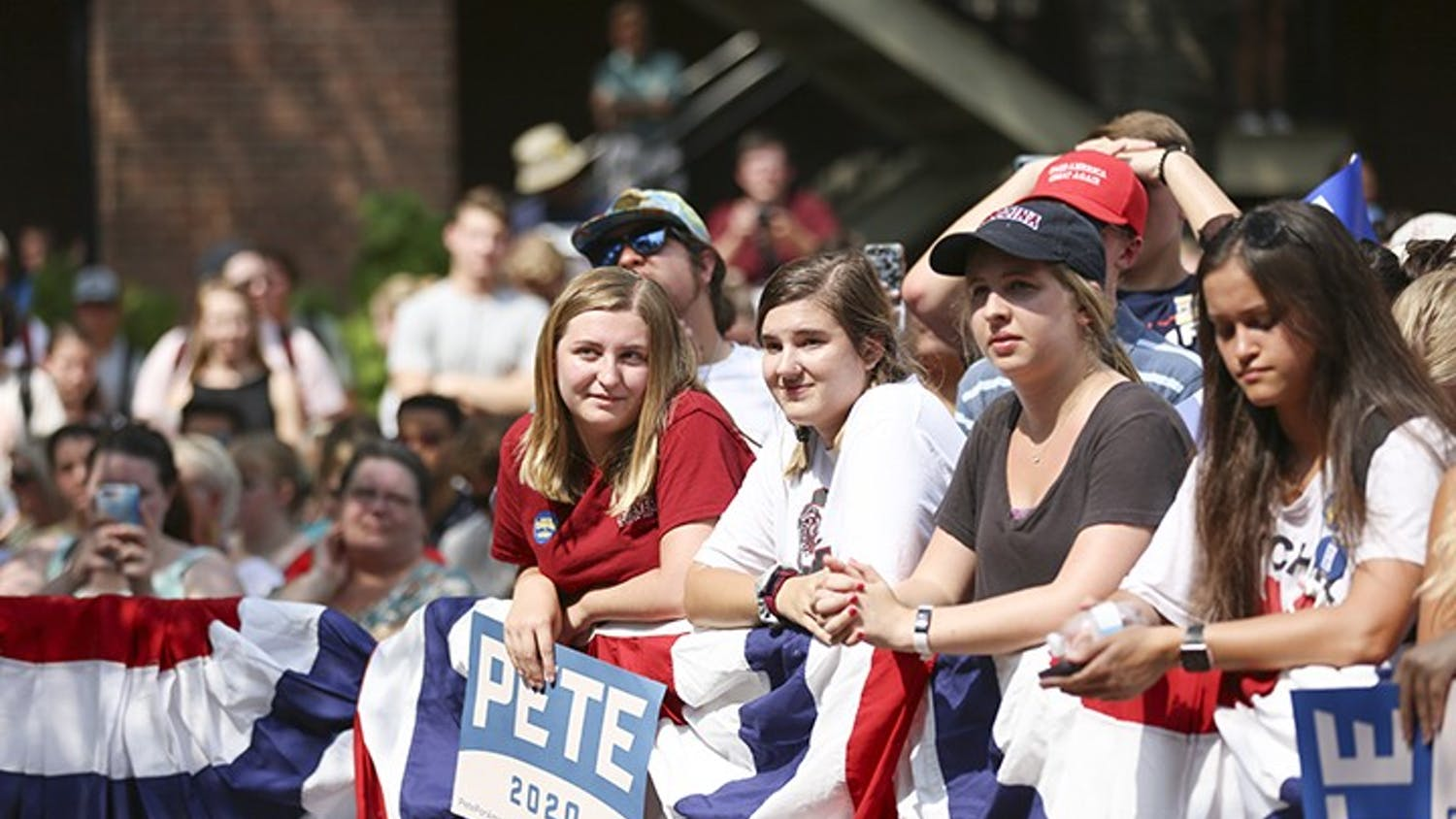 Students listen as democratic presidential candidate Pete Buttigieg speaks at Russell House on Tuesday afternoon.