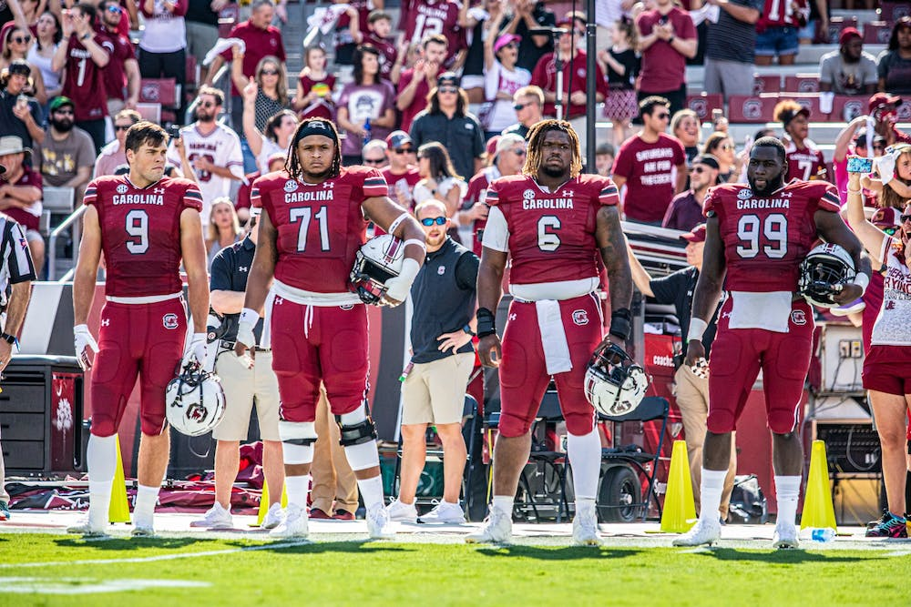 <p>Carolina players lined up awaiting to do the coin toss at the Troy Football Game on Saturday October 2, 2021.</p>
