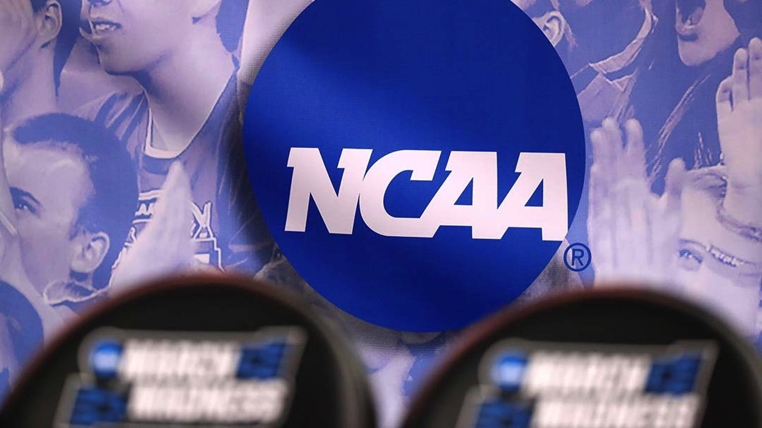 The NCAA logo during the NCAA Men's Basketball Tournament in 2017. The NCAA is changing its rules to allow players within the organization to earn money from their name, image and likeness (NIL).
