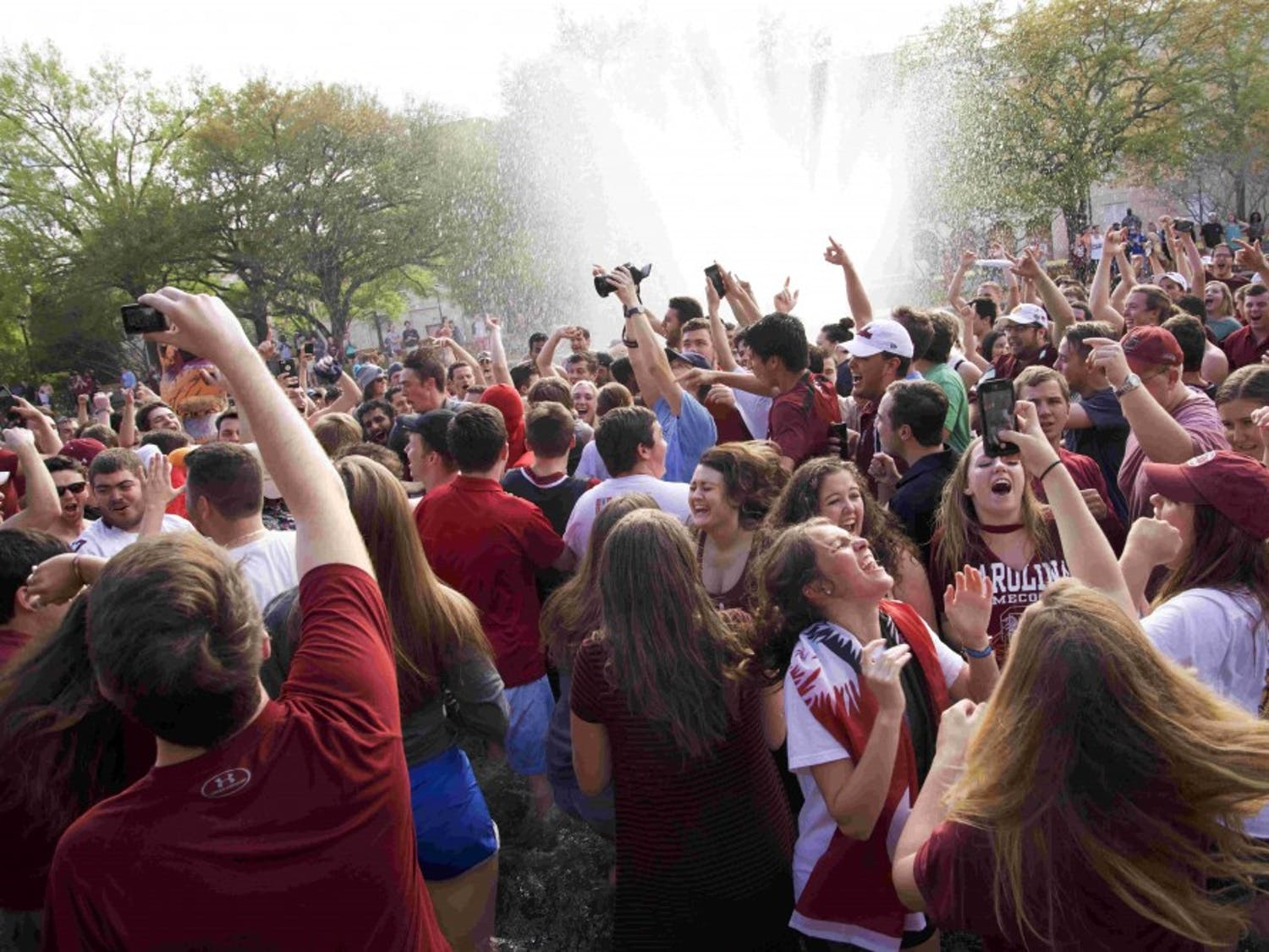 Students jump in the fountain to celebrate the Gamecocks men's basketball team beating Florida in the Elite Eight and securing its place in the Final Four in 2017.