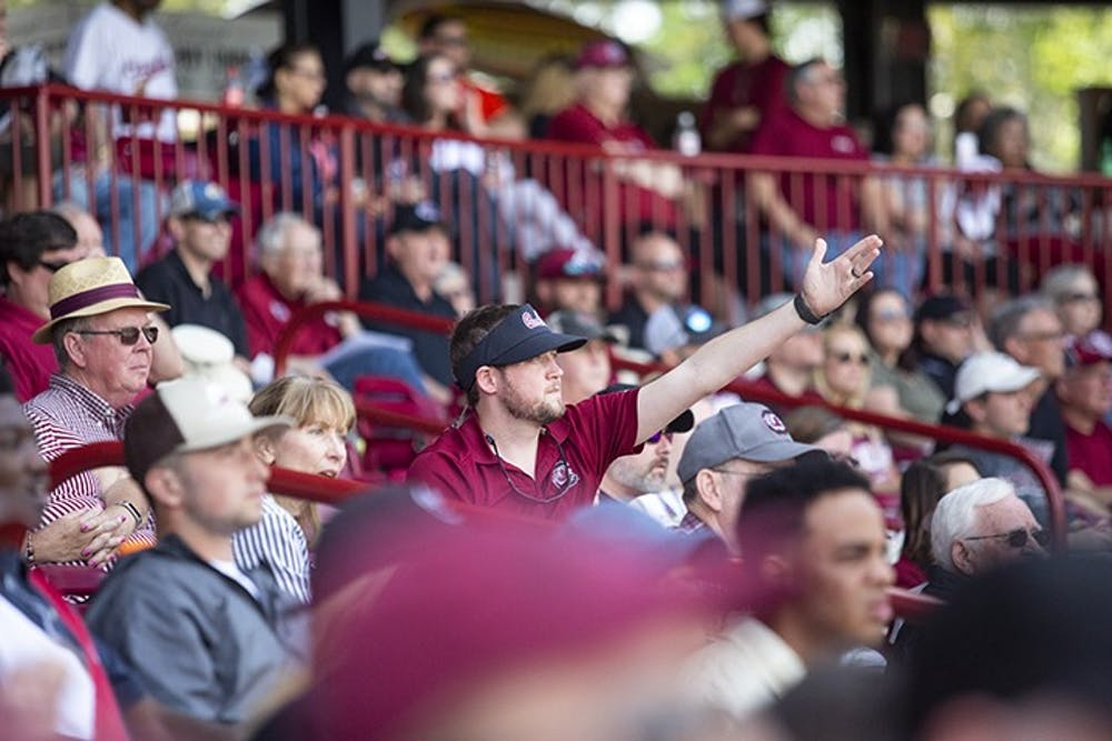 <p>Upset with a call, a South Carolina fan throws their hands up in frustration during the second game against Auburn at Founders Park in 2019.</p>